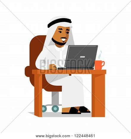 Young saudi arabic man sitting at the computer desk with laptop and working