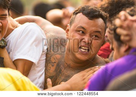 WAT BANG PHRA, THAILAND - MAR 19, 2016: Unknown participants of Master Day Ceremony at able Khong Khuen - spirit possession during the Wai Kroo ritual at Bang Pra monastery, about 50 km west of Bangkok.