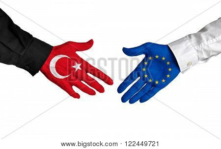 Turkey and European Union leaders shaking hands on a deal agreement
