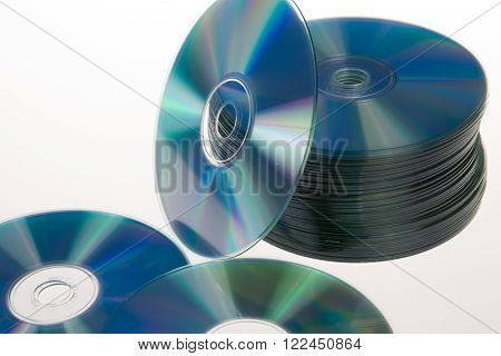 One Disc Around A Stack Of Compact Discs Isolated