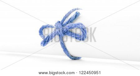 Handmade blue rope knot tied on white letter scroll, isolated