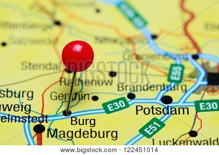 Photo of pinned Burg on a map of Germany. May be used as illustration for traveling theme.