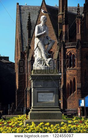 Statue of poet Robert Burns with seagull in Dumfries Scotland