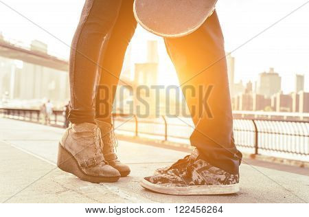 Kiss in Brooklyn. Teenager couple kissing in New york. Brooklyn bridge in the background