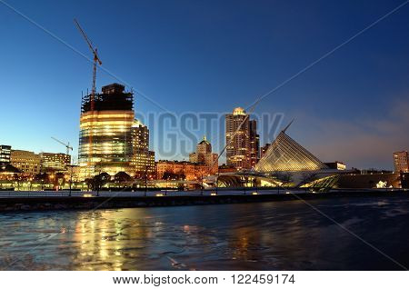 MILWAUKEE WI - FEBRUARY 12 2016: Milwaukee Lakefront Skyline at Twilight with Northwestern Mutual Tower Under Construction