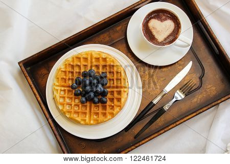 Warm Waffle Breakfast with blueberry and homemade coffee