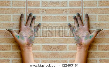 Hands too dirty with color on the wall