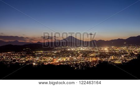 Hadano city night scape view with mountain Fuji at sunset time in autumn season
