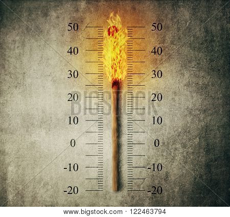 Burned match stick indicating temperature on a scale as a thermometer. Global warming and temperature rising concept