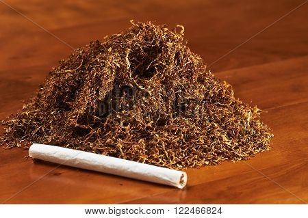 Tobacco On A Table With A Handmade Cigarette