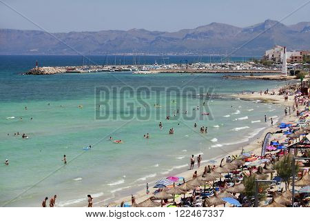 Mallorca Spain - June 28 2015: The tourists enjoiying their vacation on the beach. Up to 60 mln tourists is expected to visit Spain in year 2015.