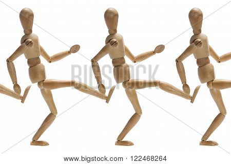 Wooden mannequins kicking each other in the backside
