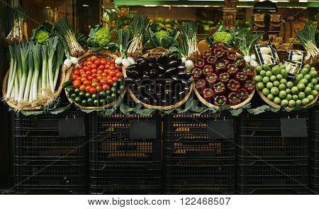 Fresh Vegetables In Baskets Presented Outside On Market For Sale
