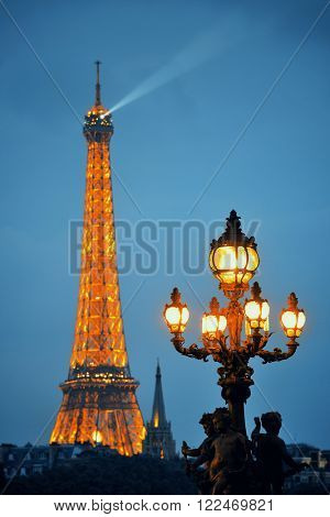 PARIS, FRANCE - MAY 13: Eiffel Tower and vintage lamp at night on May 13, 2015 in Paris. With the population of 2M, Paris is the capital and most-populous city of France