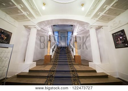 RUSSIA, MOSCOW - 15 APR, 2015: Light empire style corridor with a carpet on the stairs at theatre Modern.