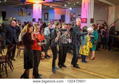 RUSSIA, MOSCOW - 14 APR, 2015: Photographers are standing in the hall at Scenary Awards Chernykh (Slovo).