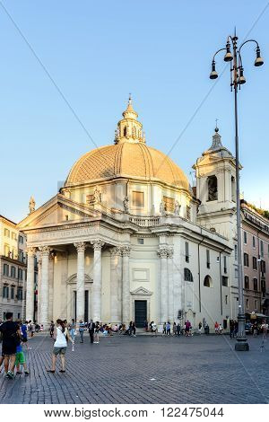 Rome Italy - August 22 2015: people walking in Popolo square in Rome the church in background