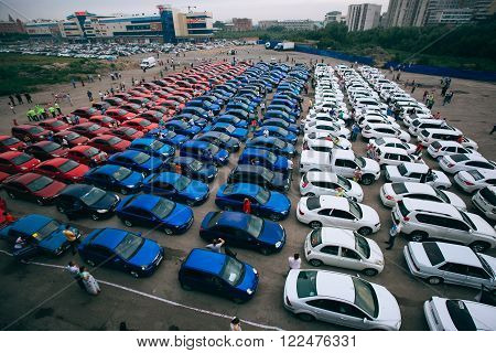 Omsk, Russia - August 22 , 2014: Russian flag car flashmob.Above view of tricolor colored cars flag of country