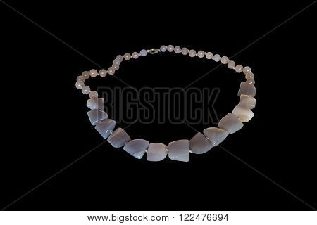 Beads from natural Brazilian agate on a white background