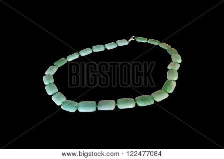 green nephrite necklace.  Isolate on black background