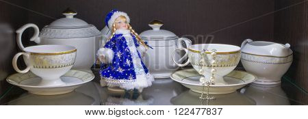 tea utensils with a pearl bracelet and Snow Maiden