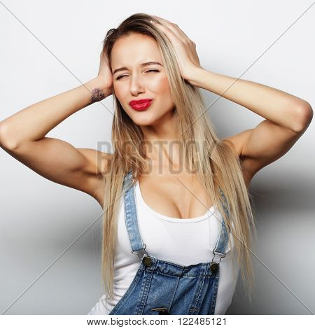 Young cute smiling blond girl