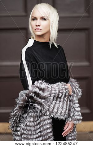 young blond woman wearing a winter look