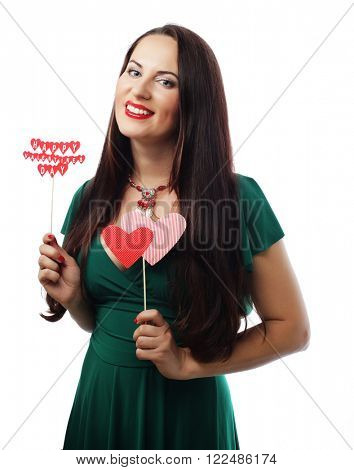 beautiful woman wearing green dress holding paper hearts