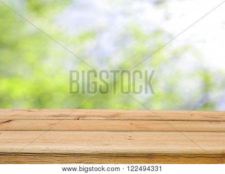 empty wooden table for product display montages with nature background