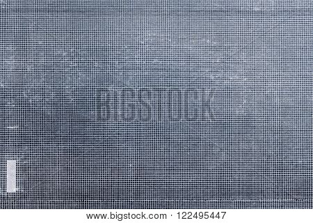 the old and worn or shabby of silvery color paper with a pattern in a cage for a vintage background or for wallpaper
