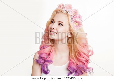Youth women with colored hair smiling. Flowers in her hair. Studio, isolated, white background