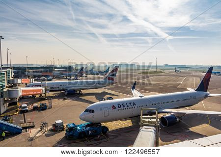 Amsterdam Schiphol Airport North Holland/the Netherlands - March 10 2016: passenger aircraft parked at the gates of the airport