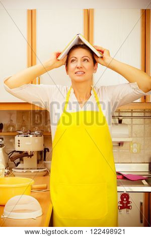 Funny Housewife With Cookbook On Head