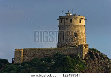 Tower Coltellazzo of Saint Efisio lighthouse at Nora archeological site, gulf of Cagliari, Sardinia, Italy
