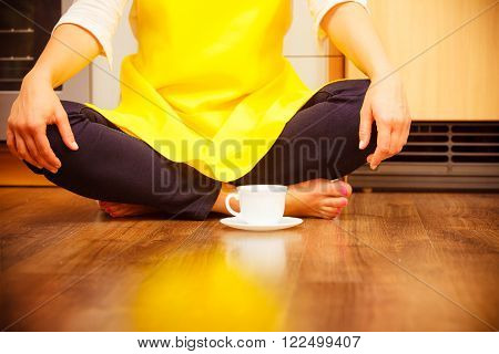 Woman With Cup Of Coffee In Kitchen.