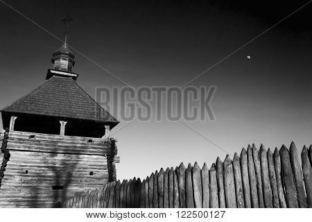 Church in the ancient fortress against the sky. Monochromatic black and white image. History ancient religion.