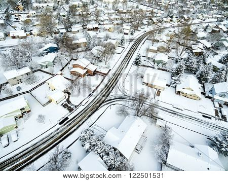 Fort Collins cityscape with fresh snow - aerial  view of typical residential neighborhood along Front Range of Rocky Mountains in Colorado, late winter  or early spring scenery