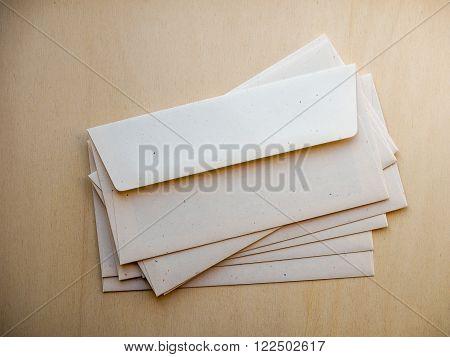 Letter Envelope On Wood Table