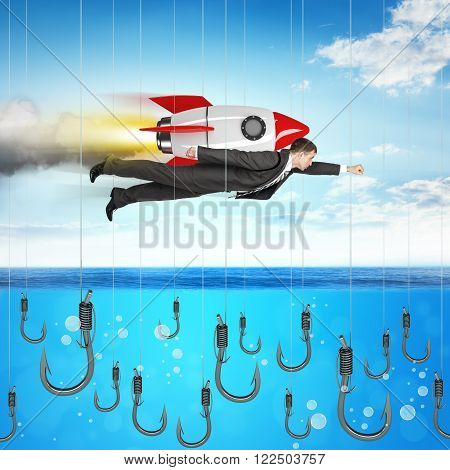 Businessman flying with rocket above ocean with fishhooks
