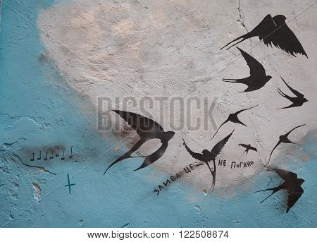 Lviv, Ukraine - Graffiti on the wall with the image of the birds and the inscription in Ukrainian