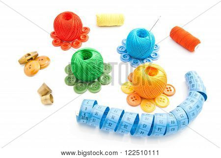Colored Spools Of Thread, Buttons And Meter