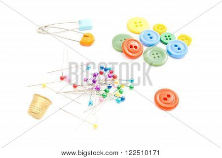 Colored Pins, Thimble And Buttons