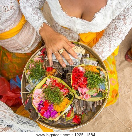 Herbs and money - ritual sacrifice on Bali, Indonesia.