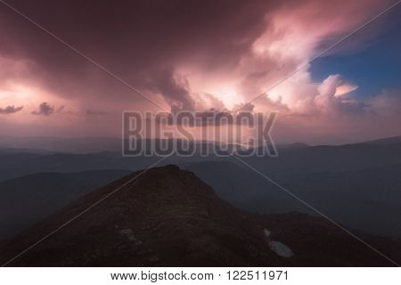 Carpathian Mountains. Mount Pop Ivan. Thunderhead and the starry sky above the ridge Montenegrin