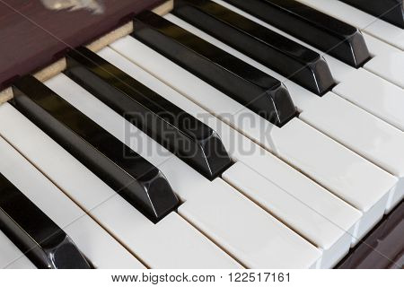 Close-up of Piano keys from a diagonal perspective and shot with a shallow depth of field
