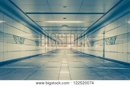 Perspective of Empty underground passage at night