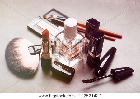 Cosmetics on light grey background