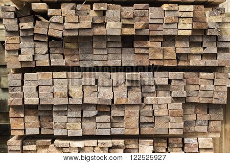 Pile of stacked rough cut lumber in the factory