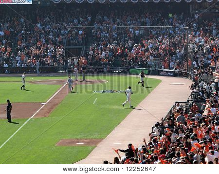 Giants Walk Towrds Dugout After Pitcher Matt Cain Strikes Out Batter