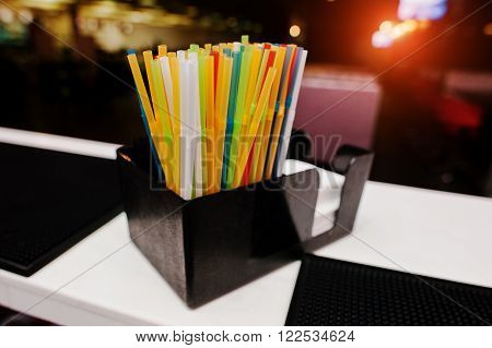 multi color drinking straws at the bar